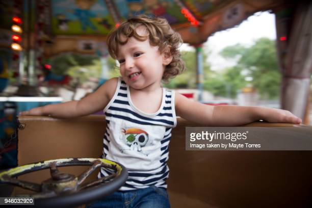 Happy toddler on the carrousel