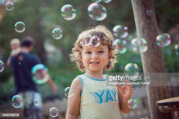 Happy toddler playing with bubbles