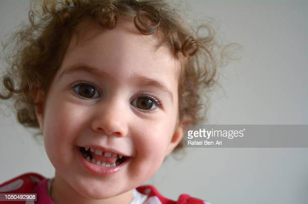 Happy Toddler Smiling and Looking at the Camera