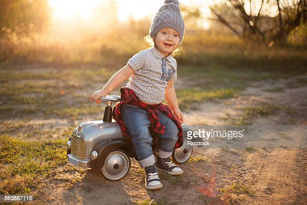 Happy toddler with retro toy car