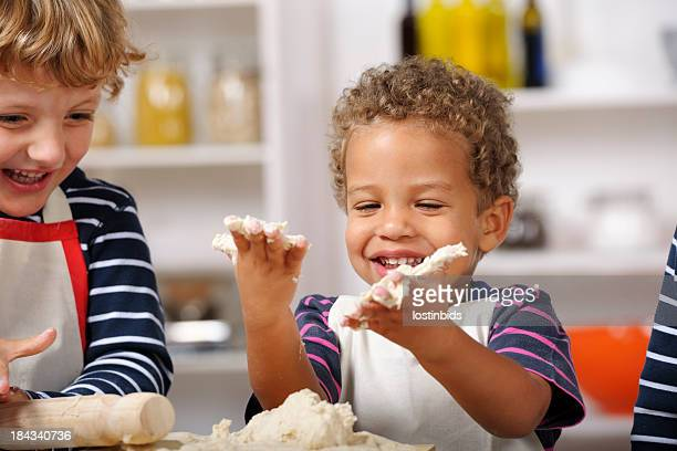 Happy Toddlers Enjoying Home Baking.