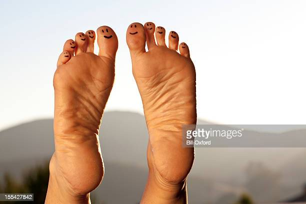 happy toes - foot massage stock photos and pictures