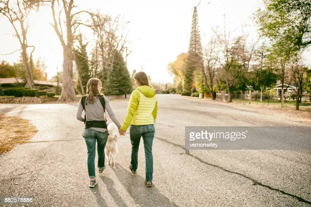 happy together, family of four walk in the evening beauty of the mountains - gender fluid stock photos and pictures