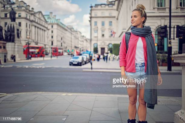 happy tourist girl is skating on the streets of london - pedestrian stock pictures, royalty-free photos & images