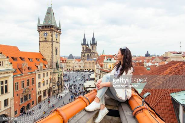 happy tourist looking at the old town square from above, prague, czech republic - eastern european stock pictures, royalty-free photos & images