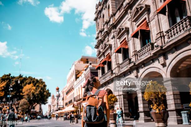 a happy tourist walking down the street - puebla state stock pictures, royalty-free photos & images