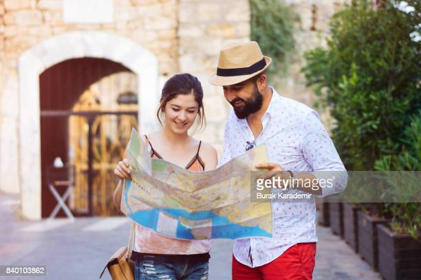happy tourists couple holding map - antalya province stock pictures, royalty-free photos & images