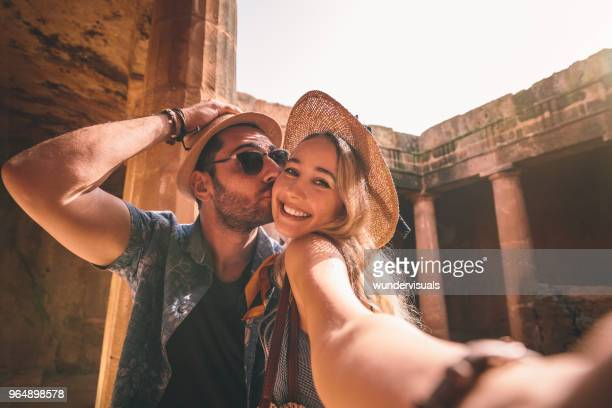 happy tourists couple taking selfies on summer holidays in greece - honeymoon stock photos and pictures