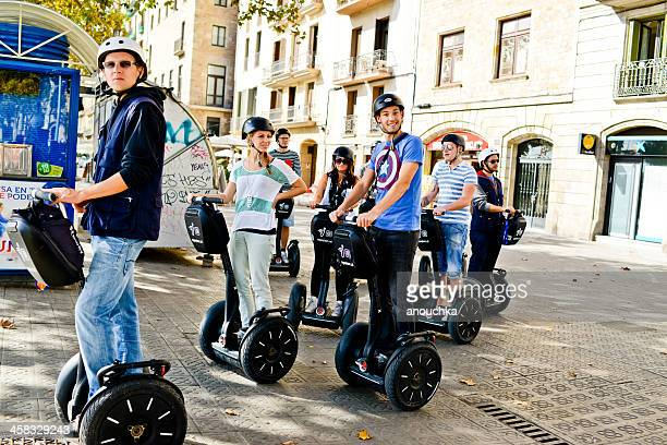 happy tourists on segway tour in barcelona, spain - segway stock pictures, royalty-free photos & images