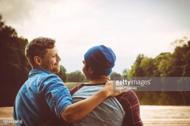 happy traveling gay couple - piedmont park atlanta georgia stock pictures, royalty-free photos & images