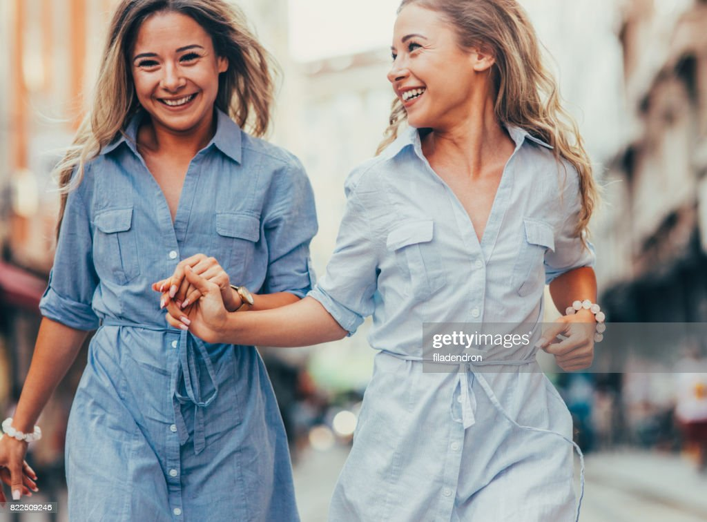 Happy twins in the city : Stock Photo