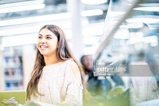 happy university student in the library - 20 29 years stock pictures, royalty-free photos & images