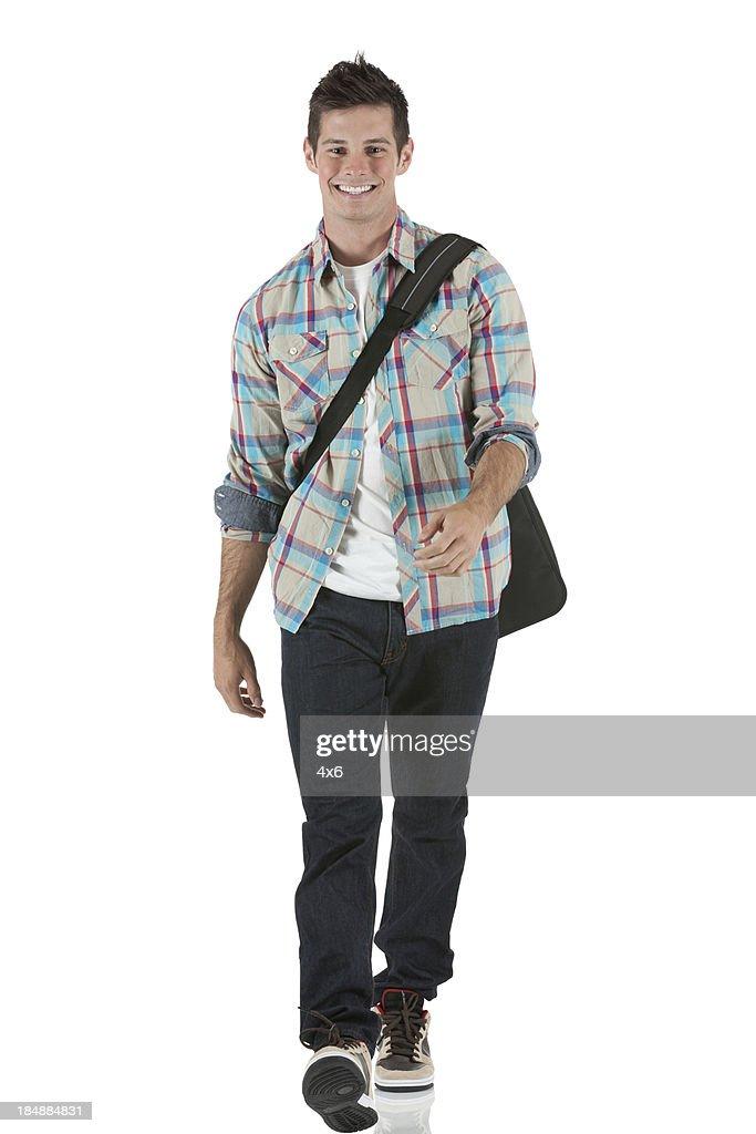 Happy university student walking : Stock Photo