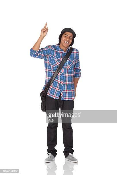 Happy university student with finger raised