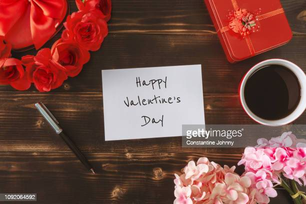 happy valentine's day on white paper over rustic wood background - valentine card stock pictures, royalty-free photos & images