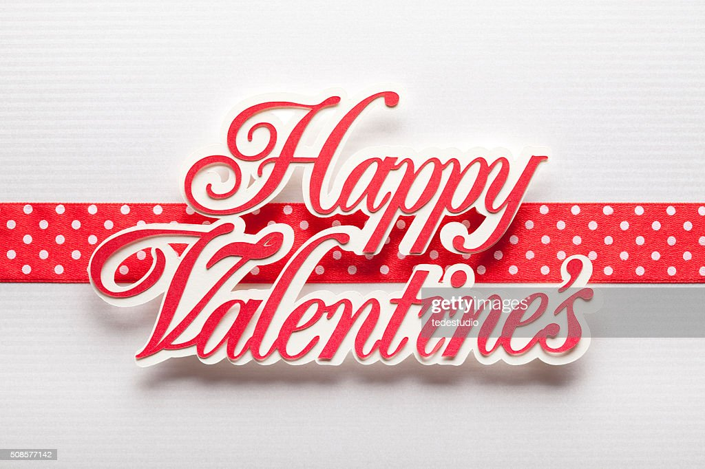 Happy Valentine's - paper sign on paper background : Stock Photo