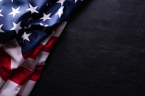 Happy Veterans Day. American flags veterans against a blackboard background. 1182562559