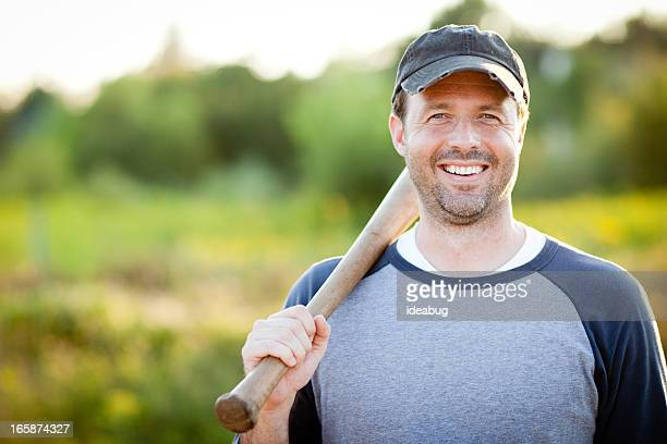 Happy, Vintage Baseball Player with Bat Outside During Summer