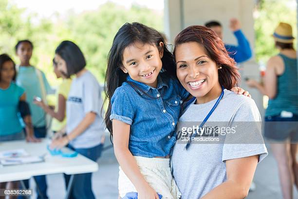 Happy volunteer physician with young patient