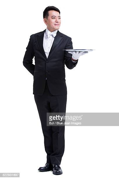 happy waiter with serving tray - formal glove stock pictures, royalty-free photos & images