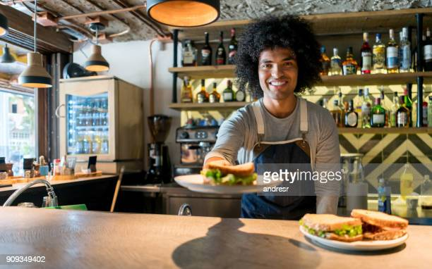 happy waiter working at a restaurant - club sandwich stock pictures, royalty-free photos & images