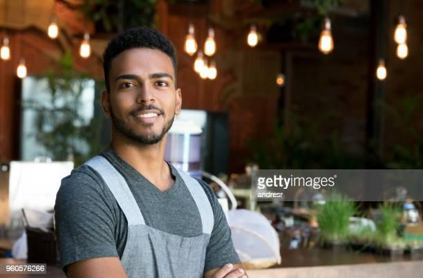 Happy waiter working at a restaurant