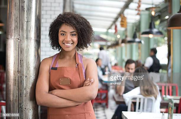 happy waitress working at a restaurant - serving food and drinks stock photos and pictures