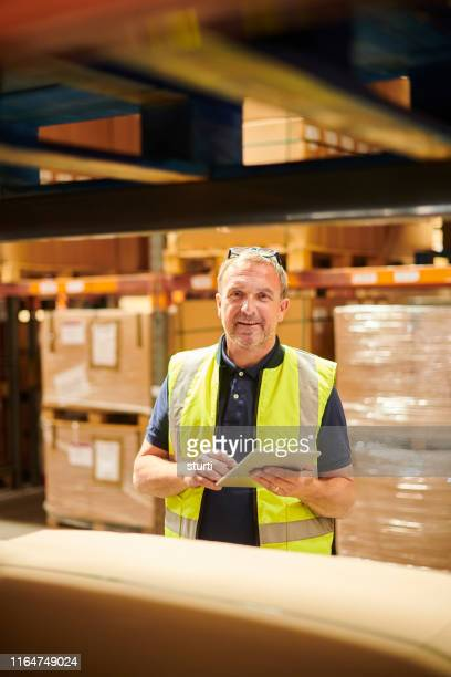 happy warehouse worker - yellow stock pictures, royalty-free photos & images