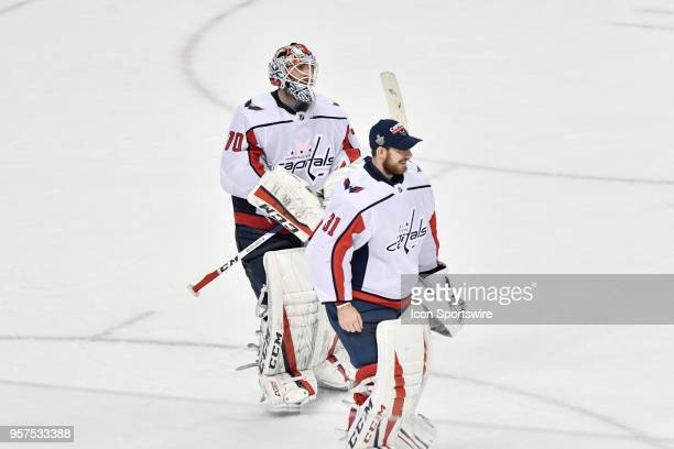 A happy Washington Capitals goalie Braden Holtby and Washington Capitals goalie Philipp Grubauer skate off the ice after the first game of the NHL...
