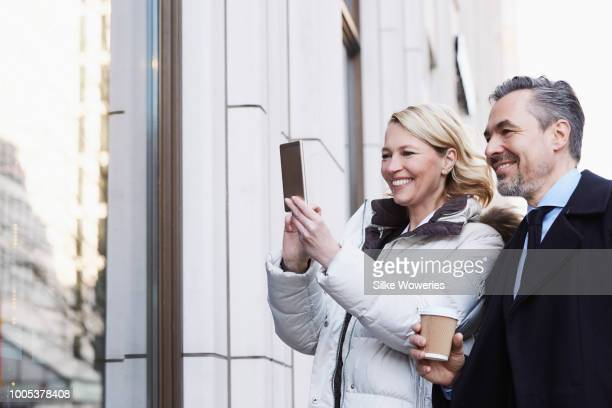 happy wealthy couple walking the city streets in winter