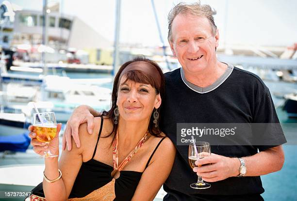 Happy Wealthy Mature Couple by the Sea
