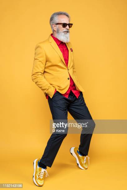happy well dressed gentleman having photoshooting in studio - metrosexual stock pictures, royalty-free photos & images