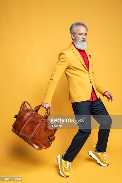 happy well dressed gentleman having photoshooting in studio - multi colored suit stock pictures, royalty-free photos & images