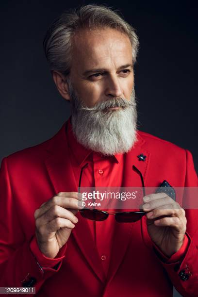 happy well dressed gentleman having photoshooting in studio - red jacket stock pictures, royalty-free photos & images
