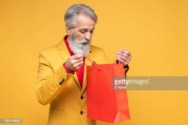 happy well dressed gentleman with shopping bags - multi colored suit stock pictures, royalty-free photos & images