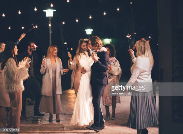 happy wife and groom dancing at night outdoors wedding reception - matrimonio foto e immagini stock