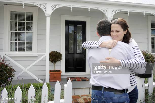 happy wife hugs her husband front