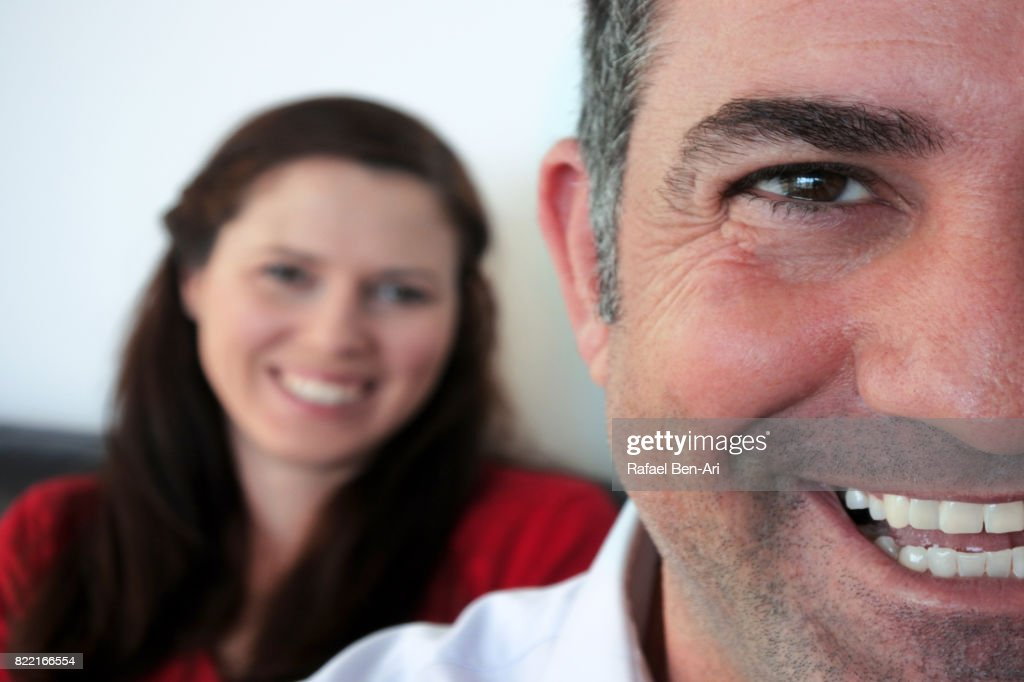 Happy wife looks at at her happy husband : Stock Photo