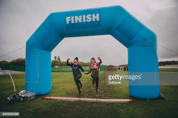 happy winners - finish line stock pictures, royalty-free photos & images
