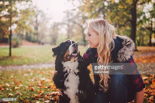 Happy woman and dog in a park