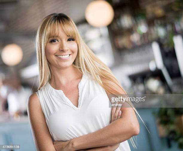 Happy woman at a bar