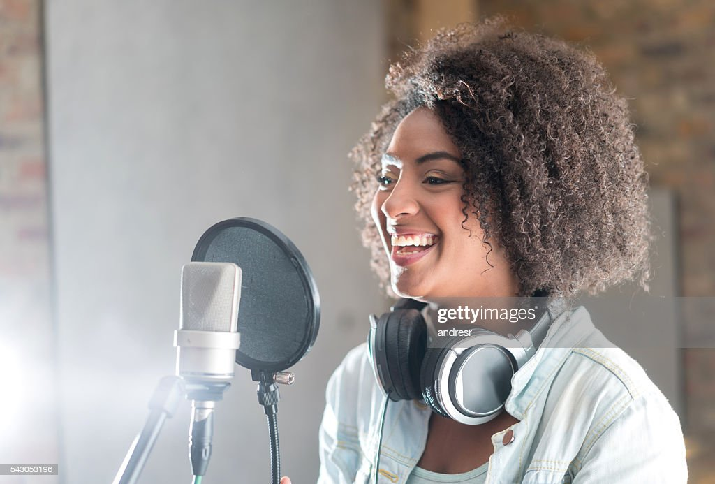 Happy woman at a recording studio : Stock Photo