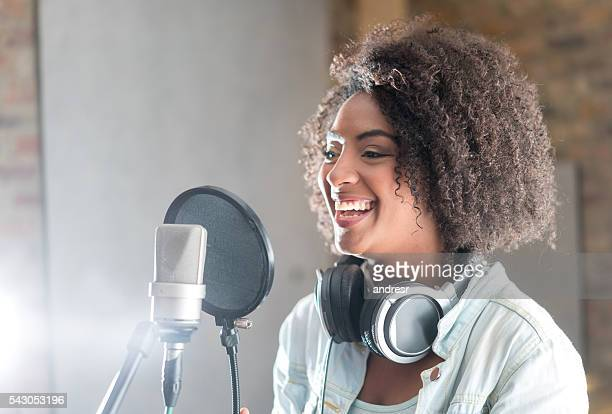 happy woman at a recording studio - sound recording equipment stock pictures, royalty-free photos & images
