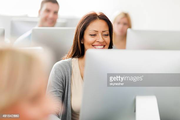 happy woman at computer class. - computer lab stock pictures, royalty-free photos & images