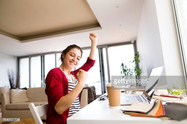 Happy woman at desk at home