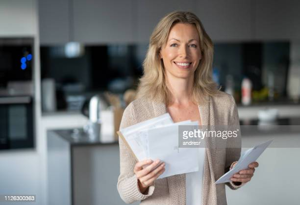 Happy woman at home checking her mail