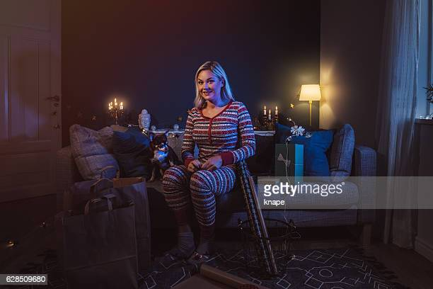 happy woman at home with christmas gifts - gel effect lighting stock photos and pictures