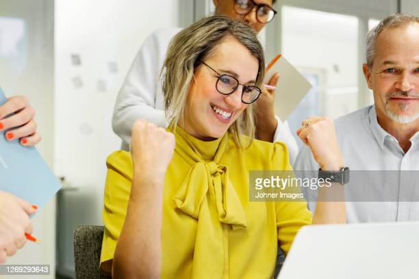 happy woman at meeting - fist stock pictures, royalty-free photos & images