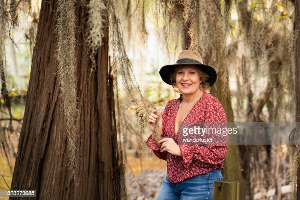 happy woman at swamp, caddo lake, tx - texas stock pictures, royalty-free photos & images