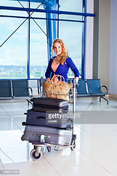 Happy woman at the airport